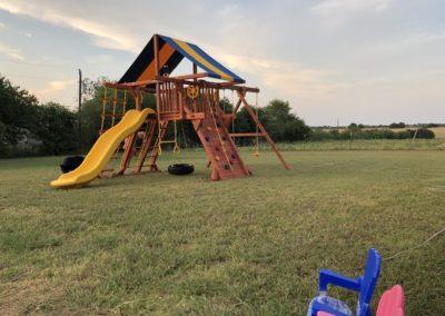 Farm-and-yard-55-Jaguar-playground-2-wacky-wave-slide-customer-3
