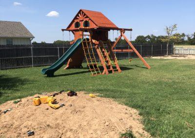 Farm-and-yard-65-Jaguar-Playground-wood-roof-treehouse-greenslide-customer-1