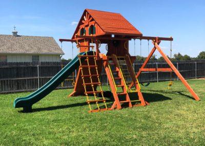 Farm-and-yard-65-Jaguar-Playground-wood-roof-treehouse-greenslide-customer-2