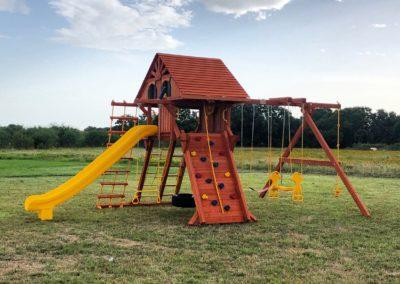 Farm-and-yard-65-Jaguar-Playground-wood-roof-treehouse-greenslide-customer-3