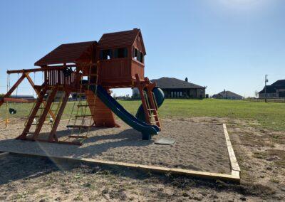 Farm-and-yard-megasized-rr-cabin-spiral-slide-customer-4